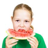 Picture of young girl and  slice of watermelon Stock Photos