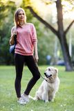 Picture of young girl on walk with dog in summer Royalty Free Stock Images