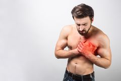 A picture of young and good-looking having a heart ache in his chest. It`s is quite unusual for his age to have this royalty free stock images