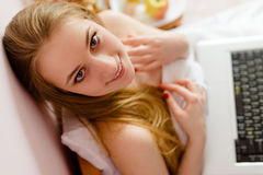 Picture of young happy blonde lady with laptop Royalty Free Stock Images