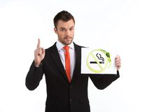 Picture of young man pointing up on white background. Royalty Free Stock Image