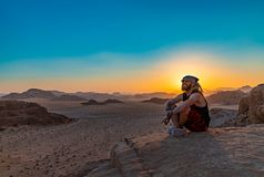Wadi Rum Sunset V. A picture of a young man similing in Wadi Rum`s landscape at sunset stock image