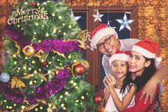 Young family celebrating Christmas at home Royalty Free Stock Image