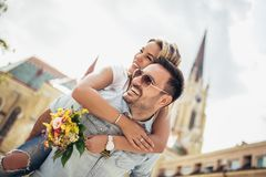 Young man surprising woman with flowers royalty free stock photos
