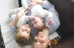Young mother hugging two little children stock photography