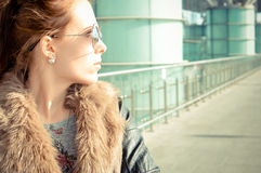 Picture of young pretty woman on city glass royalty free stock photography