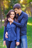 A picture of a young romantic couple in the park Stock Photos