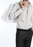 Picture of young slim male with shopping bag. Young slim metrosexual with white shopping bag Stock Photos