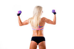 Picture of young sporty woman showing her biceps stock photos