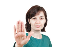 Picture of a young woman doing a stop gesture Stock Photos