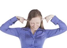Picture of  young woman with fingers in ears. Over white Royalty Free Stock Photos