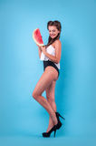 Picture of young woman holding a big slice watermelon in the studio Royalty Free Stock Photo