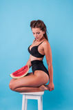 Picture of young woman holding a big slice watermelon Royalty Free Stock Photo