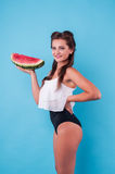 Picture of young woman holding a big slice watermelon Stock Photo