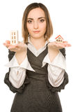 Picture of a young woman offering two buildings Royalty Free Stock Image
