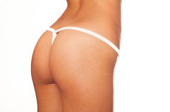 Picture of a young womans buttocks Stock Images