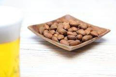 Almonds in a wooden plate Royalty Free Stock Photography