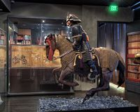 Ancient Samurai on horseback, Dallas, Texas. Pictured is an ancient samurai armor suit and horse equipment in The Ann and Gabriel Barbier-Mueller Museum.  The Stock Image