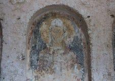 Damaged Fresco in La Chiesa Di Lama D` Antico, Parco Rupestre Lama D`Antico. Pictured is a badly damaged fresco in an ancient cave church, La Chiesa Di Lama D` Royalty Free Stock Image