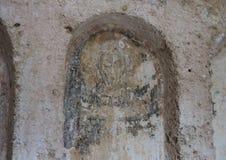 Damaged Fresco in La Chiesa Di Lama D` Antico, Parco Rupestre Lama D`Antico. Pictured is a badly damaged fresco in an ancient cave church, La Chiesa Di Lama D` Stock Image