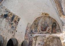 Damaged Frescos in La Chiesa Di Lama D` Antico, Parco Rupestre Lama D`Antico. Pictured are badly damaged frescos in an ancient cave church, La Chiesa Di Lama D` Stock Image