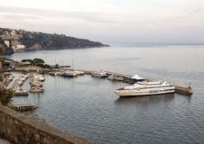 Bay of Naples Marina Grande and adjacent boats, Sorrento. Pictured is the Bay of Naples with a boat dock area and Marina Grande, a fishing village, in the royalty free stock image