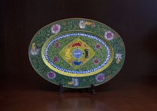 Antique oriental plate, Hue, Vietnam. Pictured is a beautiful antique oriental plate on display in Hue, Vietnam. In the center is a symbol surrounded by crabs royalty free stock images