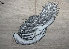 Pineapple mural Bishop Arts District, Dallas, Texas. Pictured is a black and white pineapple wall mural by artist Derek Nemunaitis in the Bishop Arts District stock image