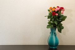 Bouquet of roses and the blue vase. Pictured a bouquet of roses and the blue vase royalty free stock photo