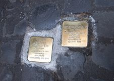 Brass plaques memorializing the death of a deported Jew. Pictured are brass plaques in the Old Jewish Ghetto in Rome, Italy memorializing the death of a deported Royalty Free Stock Photography