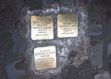 Brass plaques memorializing the death of a deported Jew. Pictured are brass plaques in the Old Jewish Ghetto in Rome, Italy memorializing the death of a deported Stock Image