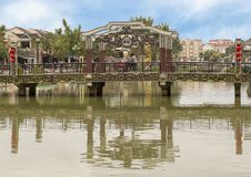 Bridge across the Thu Bon river in Hoi An, Vietnam. Pictured is a bridge across the Thu Bon River in Hoi An, Vietnam.  It is decorated with red silk lampshades royalty free stock photo