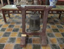 Bronze Bell inside the Hoa Khiem Temple, Tu Duc Royal Tomb, Hue, Vietnam. Pictured is an 1866 Bronze bell weighing 30.7 kilograms inside the Hoa Khiem Temple, Tu royalty free stock images