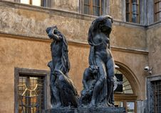 Bronze sculpture by Jan Stursa, `Night and Day` in Prague, Czech Republic. Pictured is a bronze sculpture by Jan Stursa titled `The Day and the Night`. It is stock photos
