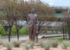 Bronze sculpture of Julius Schepps by Machael Pavolvsky in the Julius Schepps Park in Deep Ellum in Dallas, Texas. Pictured is a bronze sculpture of Julius stock image