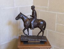 Bronze sculpture of Will Rogers on horseback, Claremore, Oklahoma. Pictured is a bronze sculpture of Will Rogers on horseback in the Will Rogers Memorial Museum Stock Photo