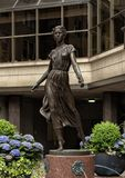 Bronze girl with a rose sculpture in front of the entrance to the Rittenhouse Hotel, Philadelphia, Pennsylvania. Pictured is a bronze sculpture of a young girl royalty free stock photos