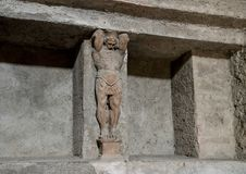 Carved figure and niche where bath supplies stored in bathhouse remains, Scavi Di Pompei. Pictured is a carved figure and niches where bath supplies were stored Stock Images