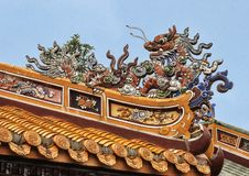 Chinese dragon atop a building in the Tu Duc Royal Tomb complex, Hue, Vietnam. Pictured is a Chinese dragon atop a building in the Tu Duc Royal Tomb complex 4 stock photography