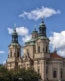 The Church of Saint Nicholas, Old Town Square, Prague, Czech Republic. Pictured is The Church of Saint Nicholas on the Old Town Square. It is a Late-Gothic and stock photography