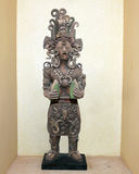 Clay statue ancient Mayan holding corn stock photography