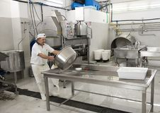 Cleanup after cheese making, L`Amordi Latte, a company that produces all types of cheese in Cavallino, Italy. Stock Photo