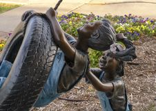 Backyard Adventure by Missy Vandable, bronze sculpture in Edmond, Oklahoma. Pictured is a close up view of a bronze sculpture titled `Backyard Adventure` by Royalty Free Stock Photography
