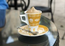 Coffee ice cream drink, Cafe Della Villa, Locorotondo, Italy. Pictured is a closeup view of a delicious coffee ice cream drink in a ceramic cup and saucer Royalty Free Stock Image
