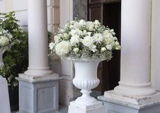 Beautiful wedding flower arrangement white roses, hydrangeas and peonies, Sorrento. Pictured is a closeup view of a large vase filled with a wedding flower Stock Photo