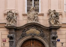 Entrance to the Piarist College and Gymnasium, Prague, Czech Republic. Pictured is a closeup view of the top of the entrance to the Piarist College and Gymnasium royalty free stock photo