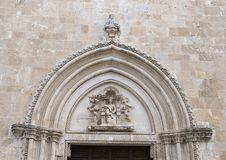 Madonna and Child above the entrance of the Ostuni Cathedral. Pictured is a closeup view of the top of the entrance to  the 15th Century Ostuni Cathedral.  The Royalty Free Stock Photography
