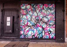 Mural by SePer DFR in Di Bruno Brothers store, Italian Market, South Philadelphia. Pictured is a colorful mural by SePeR DFR decorating the outside of a historic Royalty Free Stock Photos