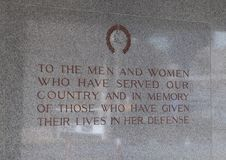 Dedication on wall near entrance to Dallas Memorial Auditorium. Pictured is a dedication to all men and women who have served, and in memory of those who have Stock Image