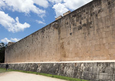 East Wall of the Great Ball Court, Chichen Itza. Pictured is the East Wall of the Great Ball Court. It is the largest and best preserved ball court in ancient Stock Image